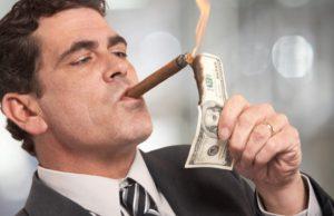 billionaire-lighting-cigar